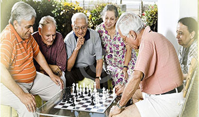 older people playing chess