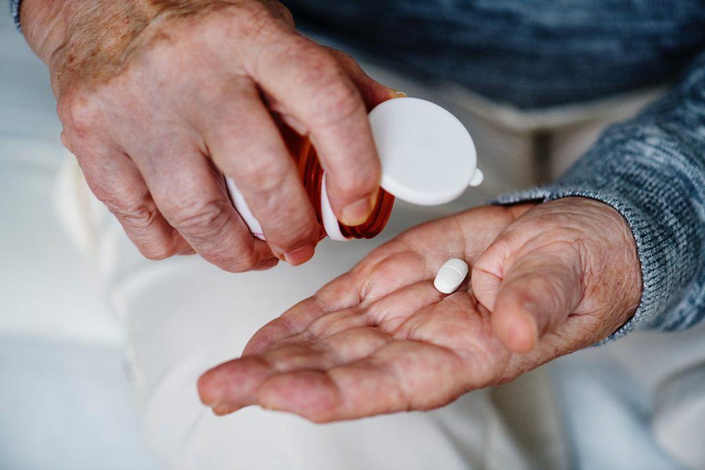 elderly taking medicine